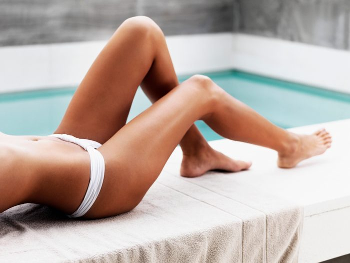 cropped shot of woman's tanned legs
