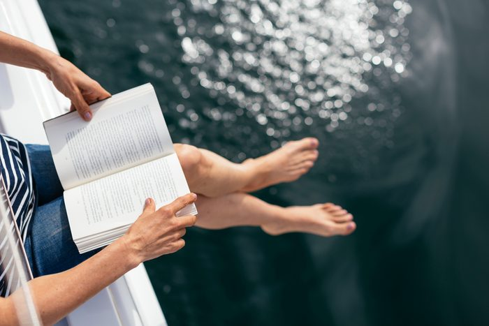 woman sitting on boat reading