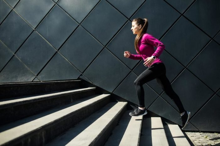 woman running jogging stairs