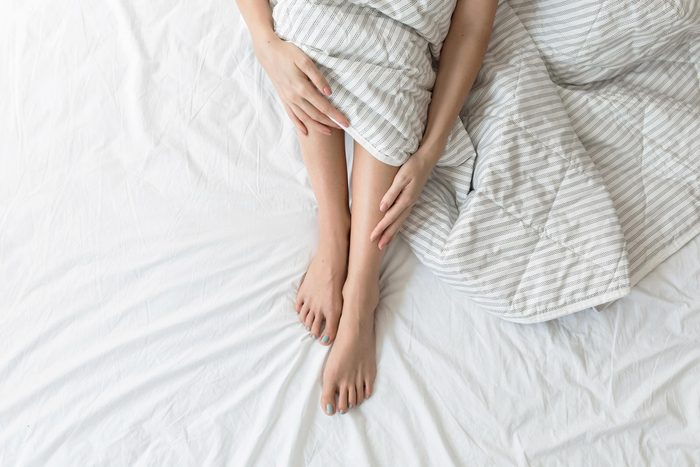 feet legs sheets bed