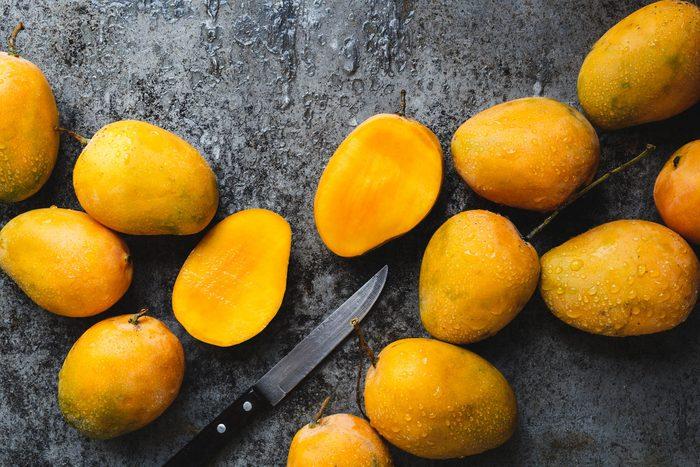 Fresh ripe mangoes with knife