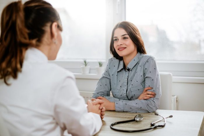 woman doctor patient appointment talk