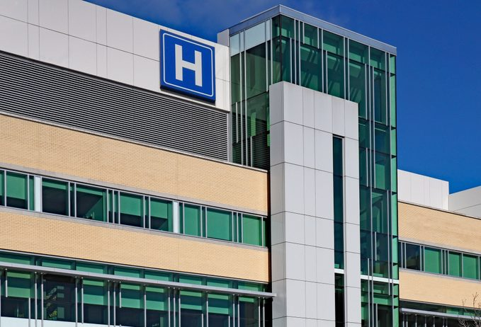 Modern style building with large H sign for hospital
