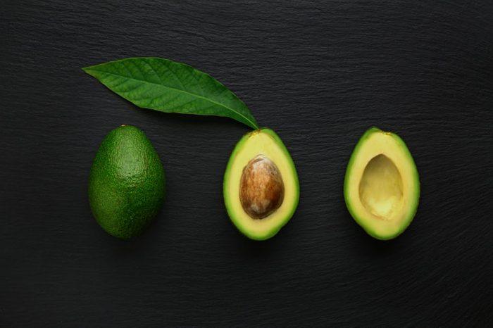 Fresh avocado on dark background