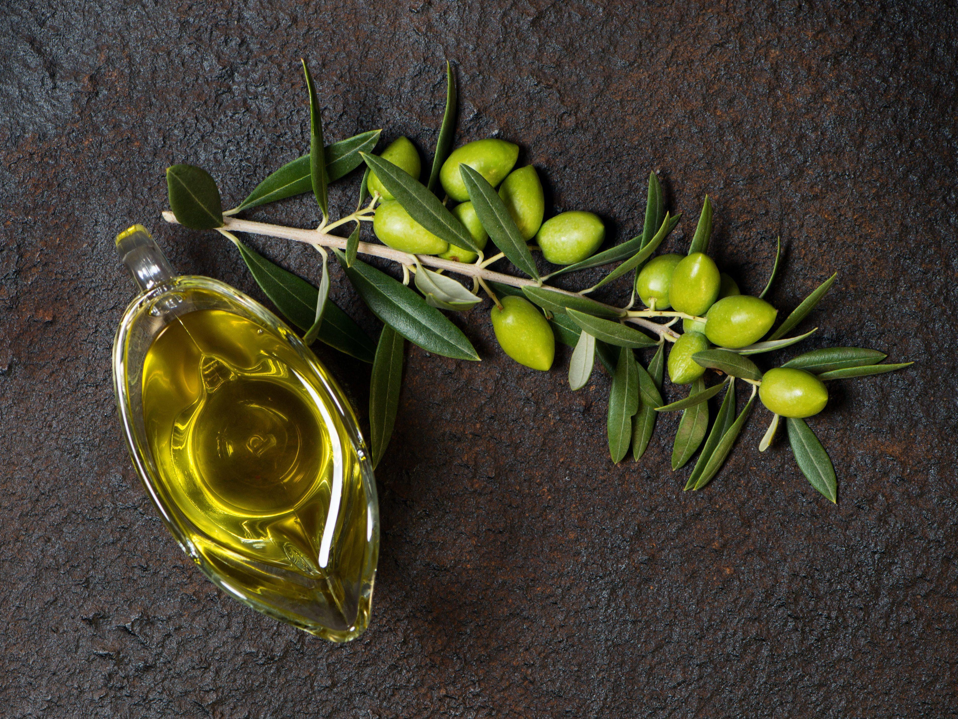 bottle of olive oil and olives