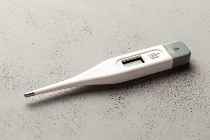 Medical thermometers electronic on gray background. Copy space for text