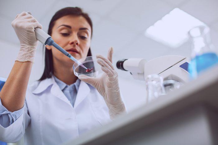 scientist in lab with blood test