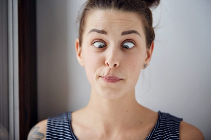 woman crossing her eyes and making a face