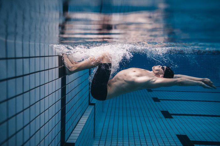 man swimming pool