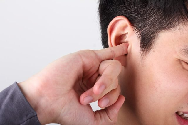 man use finger to scratching ear