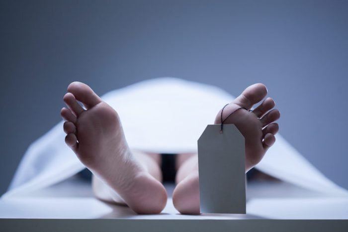 Close-up of human feet in the morgue