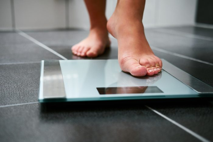 close up of feet on weight scale