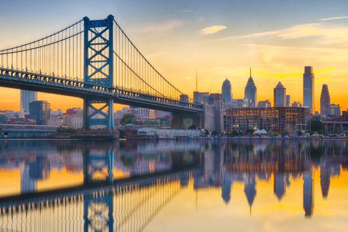 Philadelphia sunset skyline and Ben Franklin Bridge refection from across the Delaware River