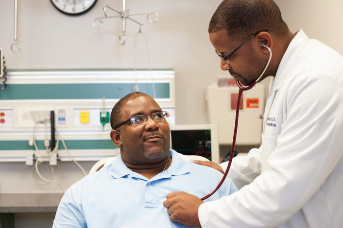 doctor listening to patient's heart