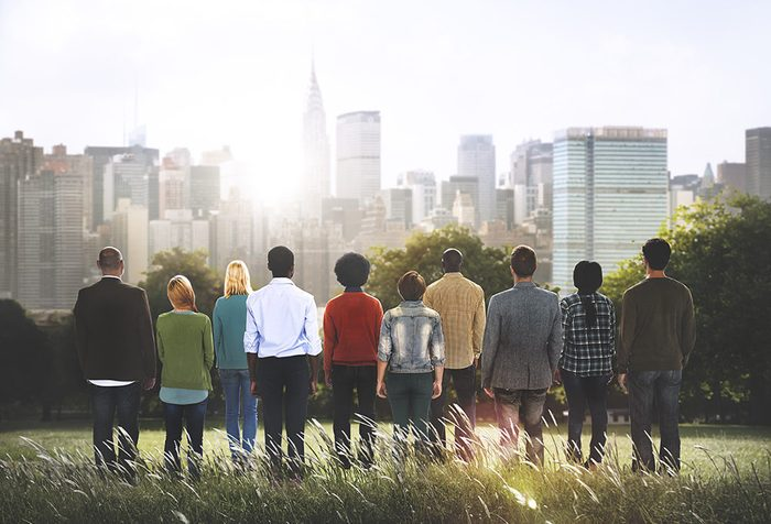 group of people overlooking city view scape