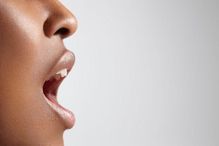 black woman mouth open