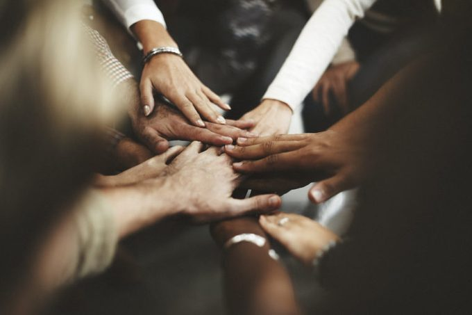 hands group together diversity helping