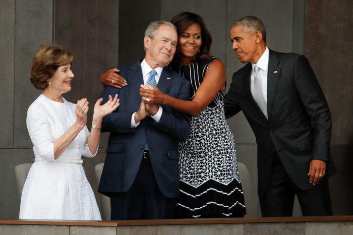 Barack Obama, Michelle Obama, Laura Bush. First lady Michelle Obama, center, hugs former President George W. Bush