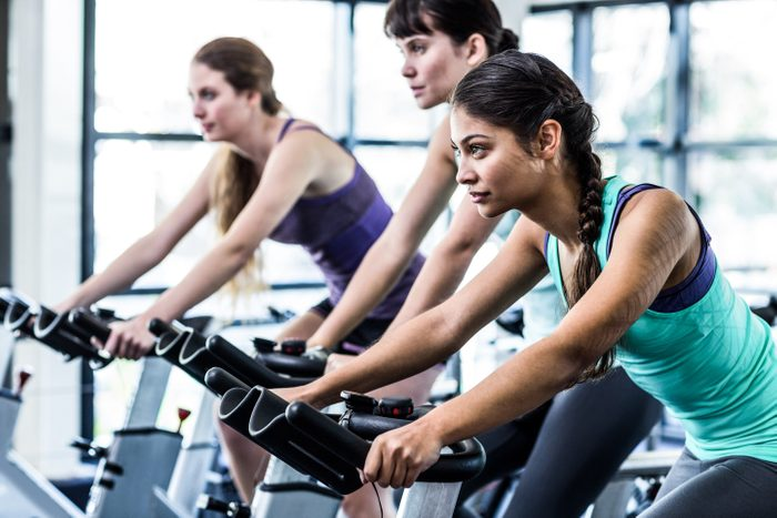 fitness class gym exercise bike diverse women