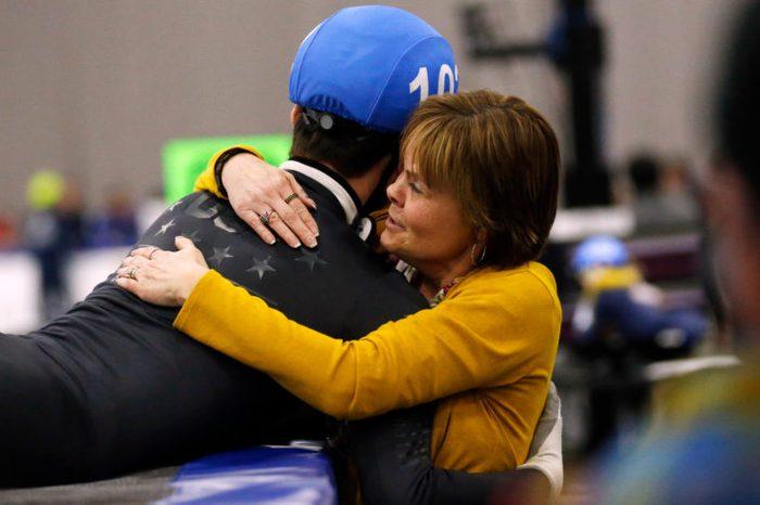 John-Henry Krueger receives a hug from his mother Heidi Krueger speedskating