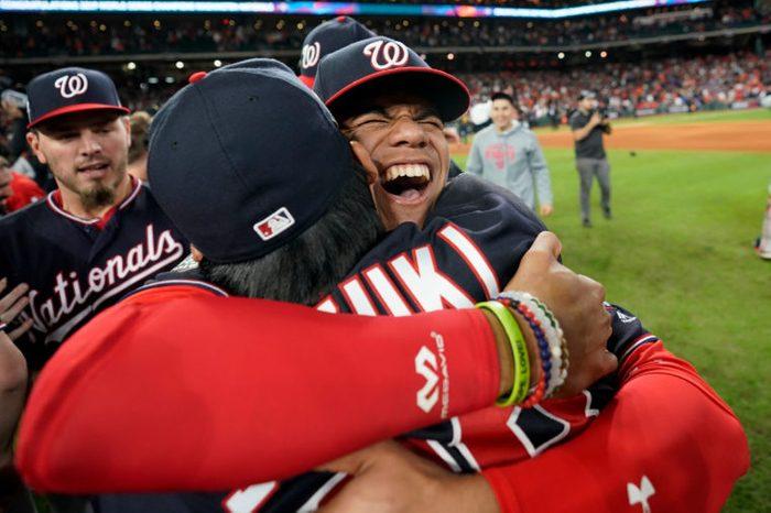 Washington Nationals left fielder Juan Soto, right, hugs catcher Kurt Suzuki