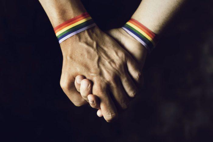 sexual orientation gay pride flag bracelets holding hands