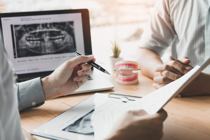 dentist and patient consultation