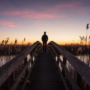 man looking at the sunset