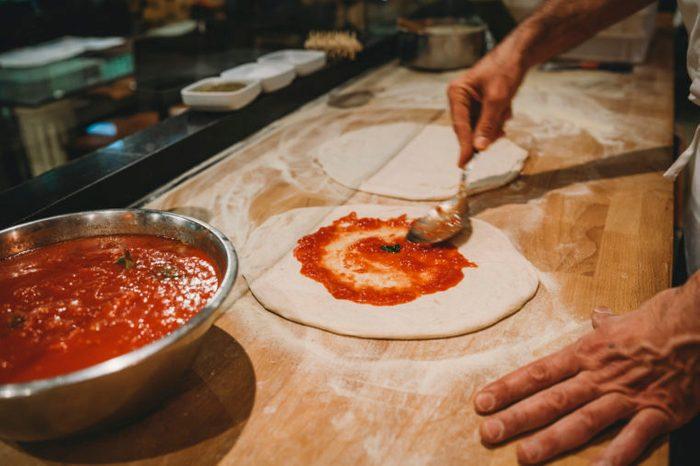 pizza chef preparing pizza