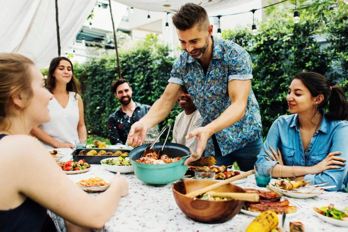 family enjoying dinner outside