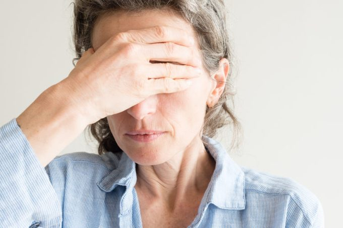 woman going through menopause symptoms