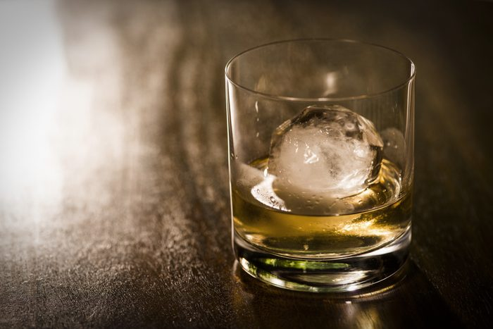 close of glass of alcohol with ice