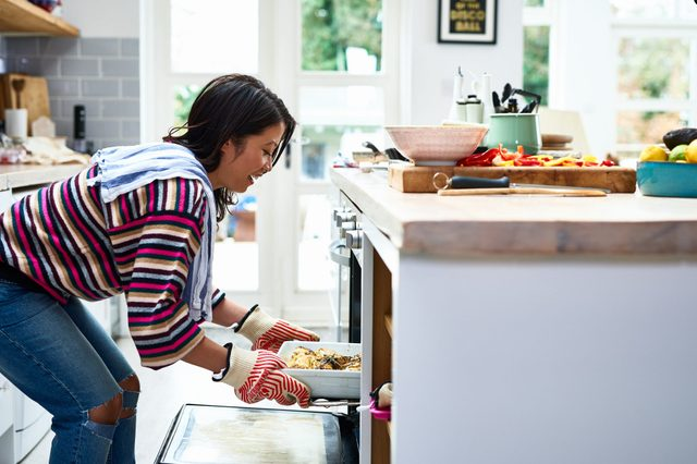 woman cooking food in kitchen