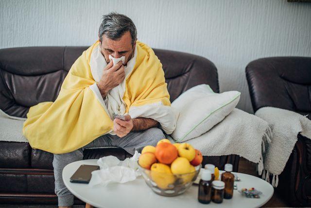 man sick at home