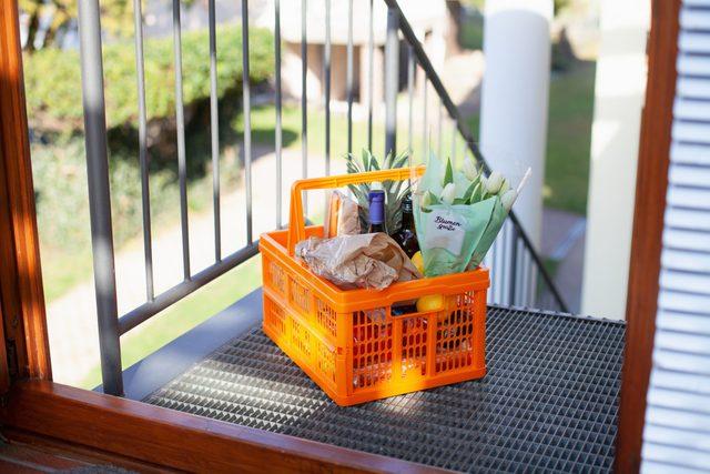grocery basket outside of home door
