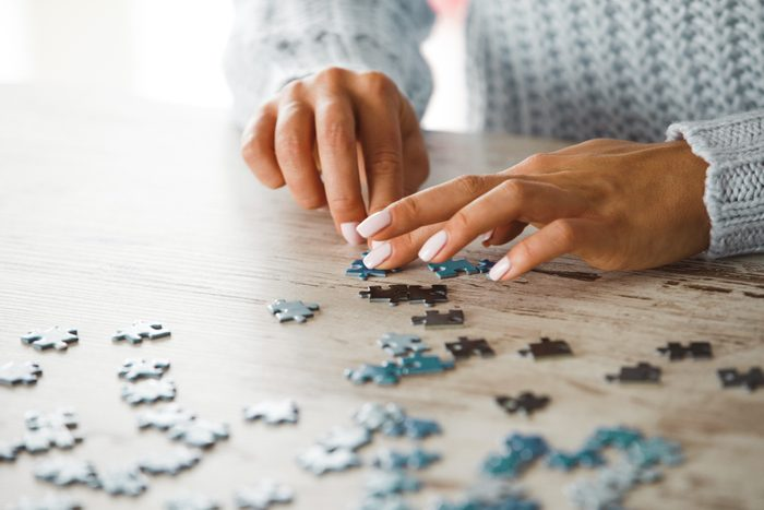 close up of woman doing a puzzle