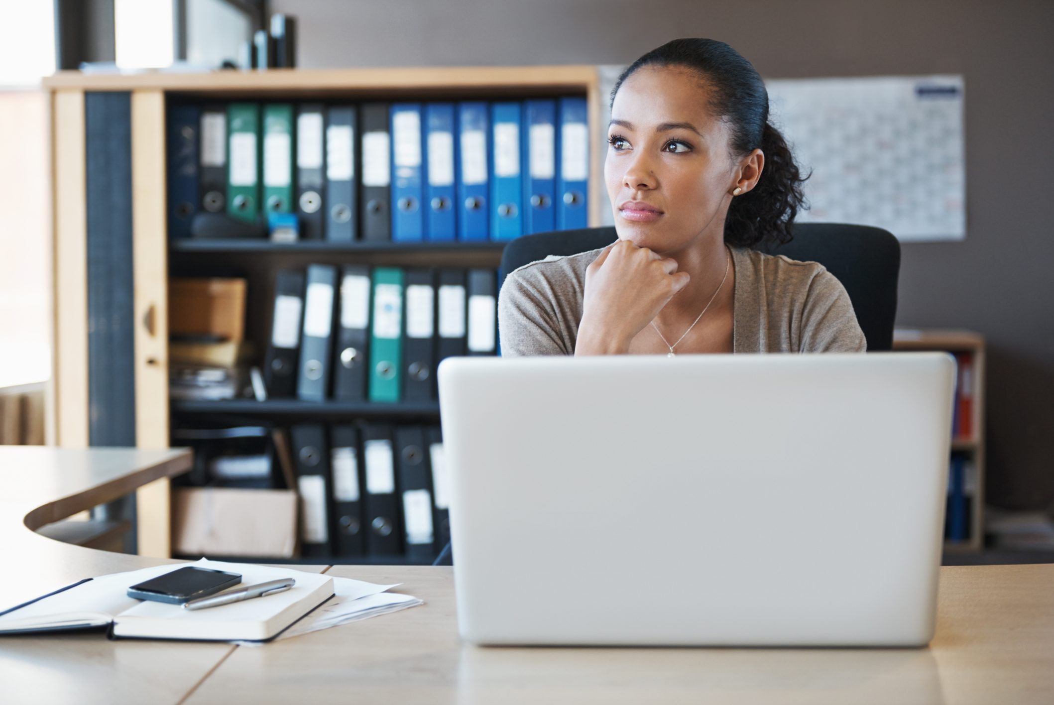 woman getting distracted while working