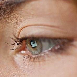 close up of screen reflection in woman's eye