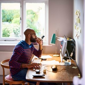 side view of young man working from home
