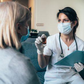 coronavirus treatment concept; doctor visiting patient in home during quarantine