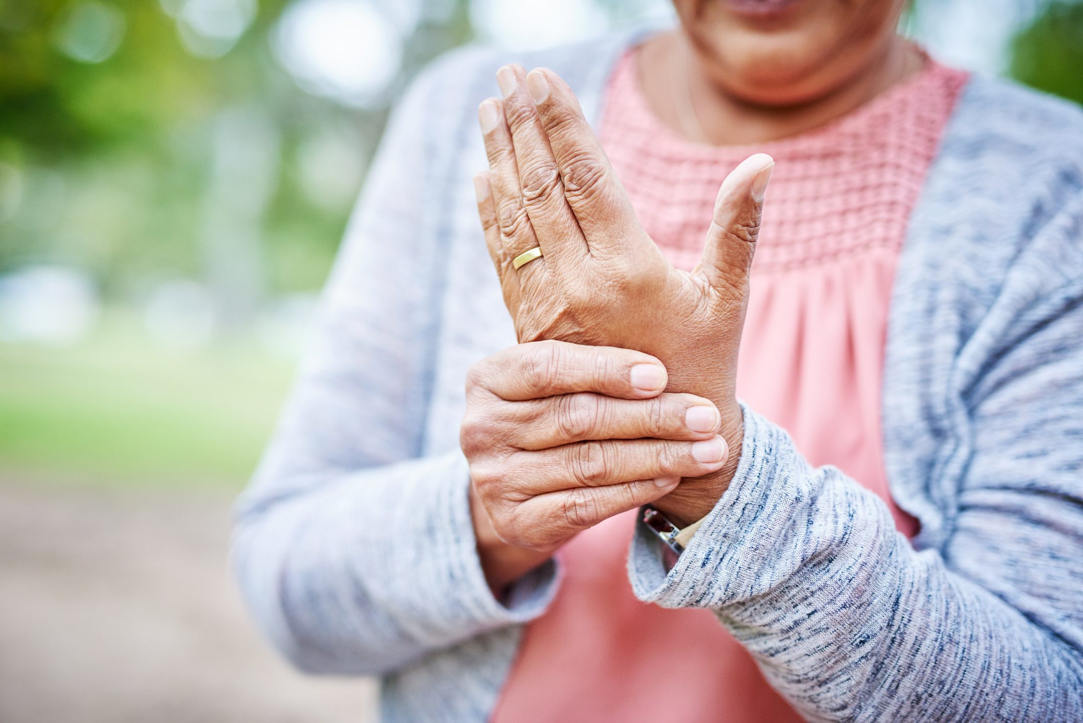 close up of woman suffering from arthritis in her hand