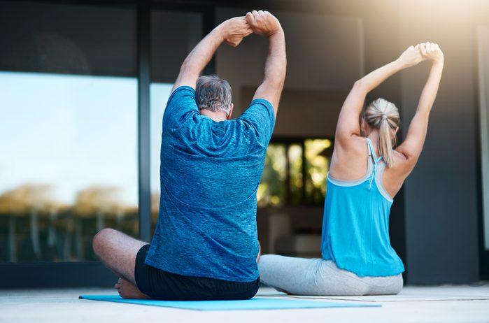 couple doing yoga outside
