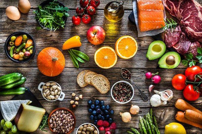 top view of rustic wooden table filled with different types of food
