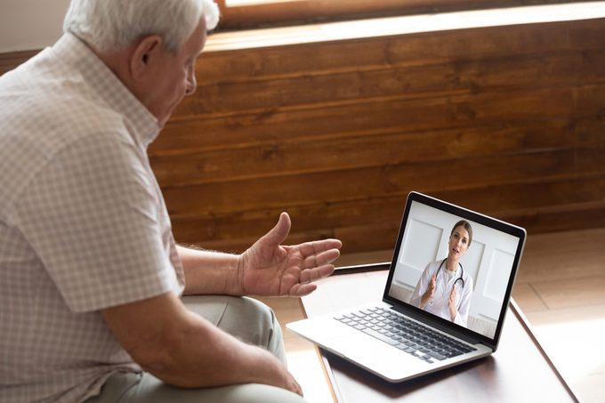 man talking to his doctor on video call