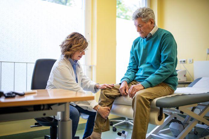 doctor examining patient's arthritis condition
