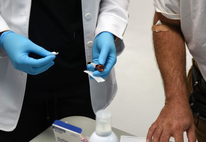 close up of health care worker taking blood sample for coronavirus antibody testing