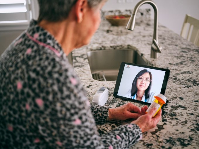 telemedicine concept; woman on video call with doctor