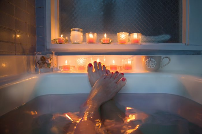 feet in bath at night time