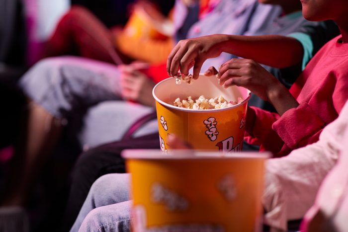 close up of popcorn bucket in movie theater
