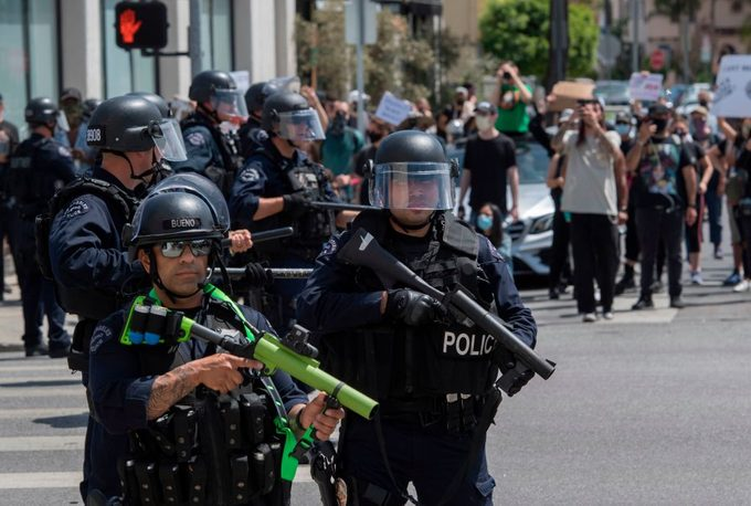 police officers armed with rubber bullet launchers in los angeles california